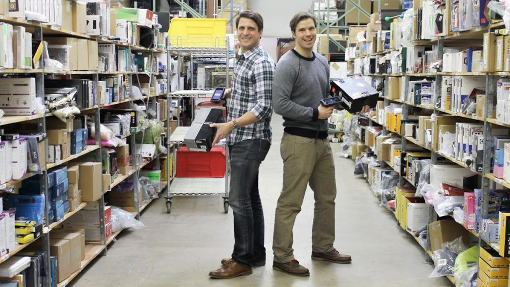 optoro founders scanning packages in a warehouse