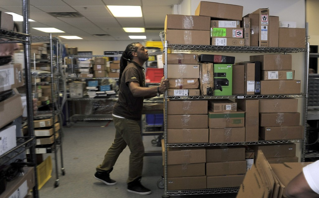 Lanham, MD -- 12/09/2014 -- Paul Alexander moves boxes of equipment into the quality control area for testing and inspection at Optoro's warehouse Tuesday, Dec 9, 2014. [ / _KF23984.JPG] (Karl Merton Ferron / Baltimore Sun)